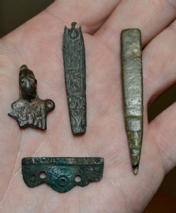A great value group of four assorted Anglo Saxon bronze artefacts from Lincolnshire. SOLD